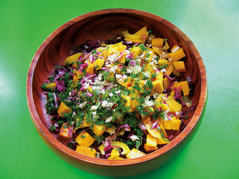 East Van Kitchen's most popular summer salad: mangos, black beans, jalapeño, red onion, cilantro and garlic tossed in a light citrus dressing! Served with tortilla chips, this salad recipe works great as a salsa, too!