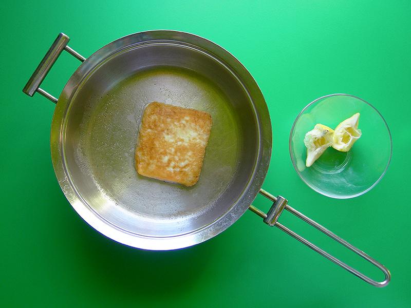 Saganaki- who can resist fried cheese?! A tasty appetizer for EVK's Greek Night dinner: salmon souvlaki, Greek salad, tzatziki, hummus, and lemon potatoes!
