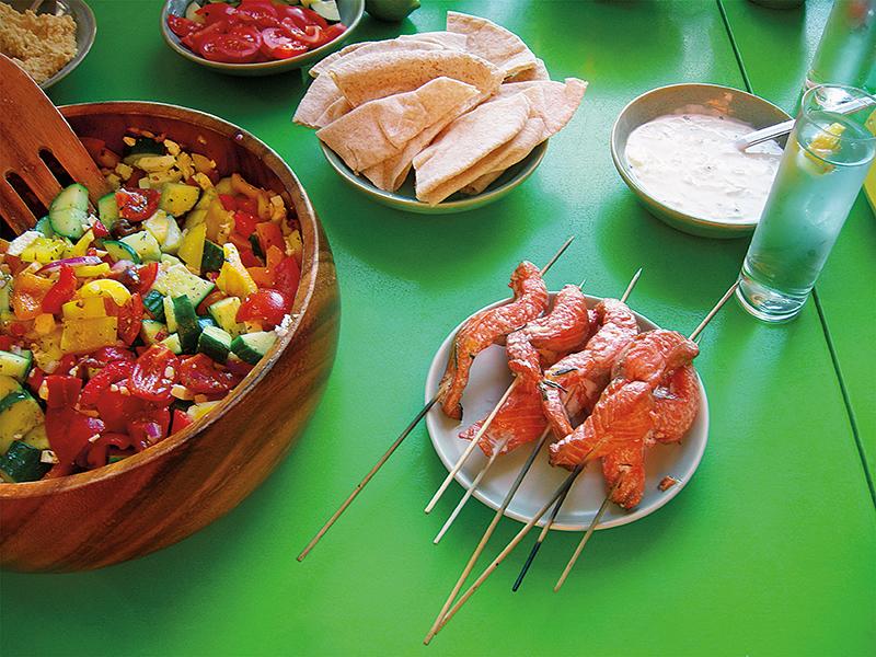 East Van Kitchen presents our Greek Night dinner: salmon souvlaki, greek salad, tzatziki, hummus, lemon potatoes