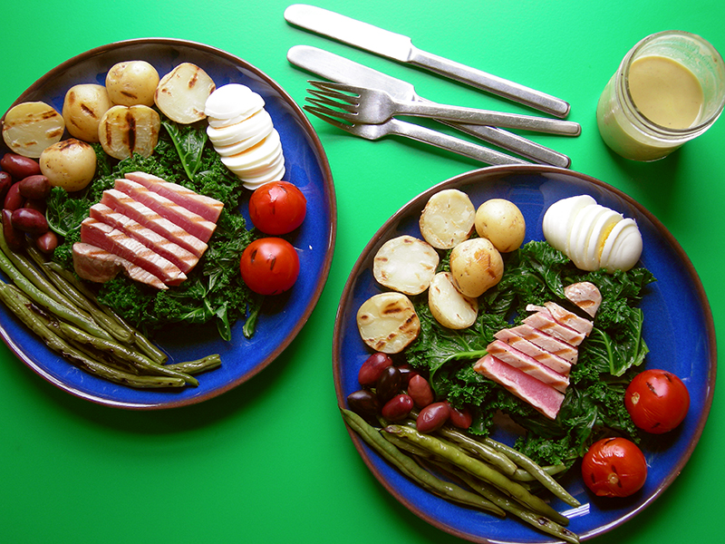East Van Kitchen's Salade Nicoise with Ahi tuna, steamed kale and green beans, olives, boiled potatoes and eggs in a tangy dressing.