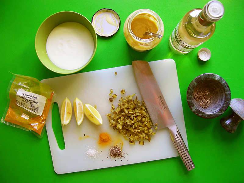 Putting a homemade tartar sauce together is easy: mix yogurt, pickles and white wine vinegar plus a few spices and you've got a delicious simple sauce for pankoed white fish on Dutch Night!
