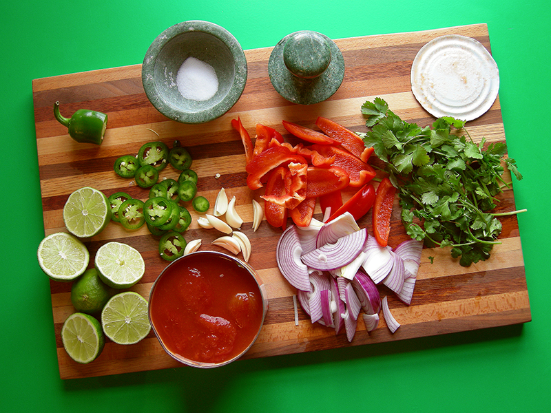This salsa will change your life. You will never, ever buy store bought stuff again! Fresh homemade salsa recipe with red peppers, jalepenos, red onions, garlic, cilantro and diced tomatoes.