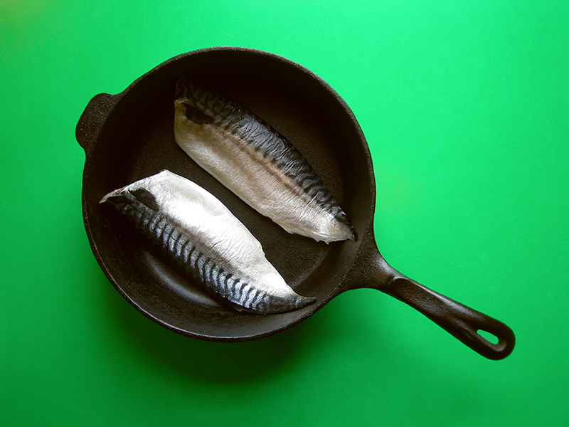 Japanese Night at EVK: Bake your fresh mackerel in a cast iron pan to your preferred crispiness. Watch for the tails beginning to curl- that's a good sign! Find more delicious world pescetarian recipes at eastvankitchen.com